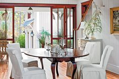 Wrap in Wood - 79 Stylish Dining Room Ideas - Southernliving. Think beyond drywall for your walls and ceiling. This dining room is completely finished with wood. A warm wood ceiling and floor treatment paired with painted wood walls adds vintage character to the space.    Tour this Modern Dogtrot Home