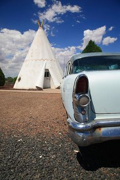"Route 66. A classic Imperial Chevrolet parked outside a Wigwam at the famous Rt. 66 motel. ""The Fine Art Photography of Frank Romeo."""