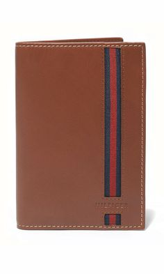 Tommy Hilfiger passport case. Your next border crossing just became a stylish one with courtesy of this sleek leather passport case, striped for a preppy finish.