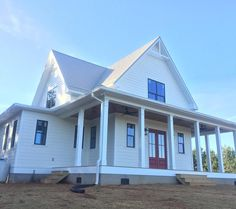 Our red front door...so excited! #fourgables #farmhouse #newconstruction #frontdoor
