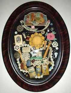 Shadow Box with Grandma's vintage sewing items in a oval glass frame.