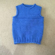 An easy, cozy vest knit in the round in bulky yarn with a garter stitch yoke and rolled finishes for extra warmth and coverage. No seaming and, after the ribbing, no purling! Baby Romper Pattern, Knit Vest Pattern, Baby Vest, Baby Cardigan, Hand Knitted Sweaters, Knitted Hats, Wool Vest, Knit In The Round, Baby Knitting Patterns
