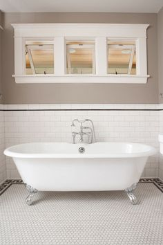 Classic Subway Tile Bathtub Surround - traditional - bathroom - minneapolis - Clay Squared to Infinity. The grey/black line near the top of the subway tile finishes it neatly. Also, love the casings around the window. Patterned Bathroom Tiles, Bathtub Surround, Bathroom Flooring, Traditional Bathroom, Black Bathroom, White Subway Tile Bathroom, Awning Windows Bathroom, Bathtub Tile, Black And White Tiles