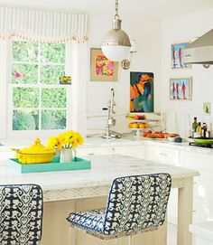 Ruthie Sommers kitchen... I absolutely love an all white kitchen with colored accessories!