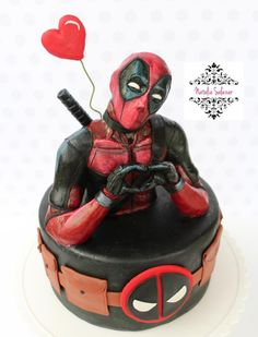 Hello everybody! This is my Deadpool cake. The topper I made it in plastic chocolate, handmade. I had so much fun doing it. I hope you like it and encourage you to comment. Deadpool Cake, Deadpool Tattoo, Deadpool Costume, Pastel Marvel, Recipe For Christmas Ornaments, Ironman Cake, Cake Cookies, Cupcakes, Marvel Cake