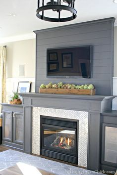 shiplap above fireplace (but white), trim around fireplace stone