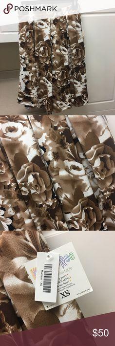 NWT LuLaRoe Madison pleated floral skirt New with tags LuLaRoe Madison floral skirt size XS. Stretchy waist. Nice quality. Knee length. LuLaRoe Skirts