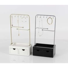 Captivating Accessory Stand With Drawer And Hooks,Assorted In 2. your fashion jewelry will be displayed for easy and quick access. Chose your favorite matching pieces when your jewelry is close by. Your stands will hold a necklace, rings and earrings and is made of sturdy metal with trays below your ring and earring organizer. Complete with hooks rods for hanging, plus 2 small drawers at the base. Perfect on a dresser, vanity or nightstand.