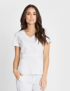 Modern Scrubs and Lab Coats for Men and Women by Jaanuu Medical Uniforms, Scrub Tops, Jaanuu Scrubs, Braids, V Neck, Cosmetology, Face, How To Wear, Clothes