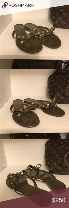 Valentino rockstud jelly sandals Gorgeous olive green color. Wanted to love these but they're just too flat for my short frame. Never even made it out of the house in them. Excellent condition. Normally I'm a size 7.5 and sized up to the 38. Valentino Garavani Shoes Sandals