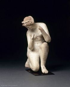 Aphrodite, the goddess of love, a very popular subject in the Hellenistic period, is seen here taking her ritual bath.   IIe siècle avant J.-C. Provenance et fabrication : Myrina   Louvre Museum   Paris