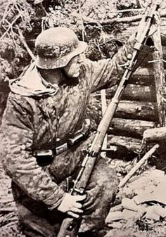 A rare photo of a Waffen SS solider preparing to fire a rifle grenade from his K98 Mauser. Hungary, 1944.