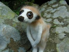 crocheted meerkat, by Craftsterer wibit. She provides a tutorial, as well.