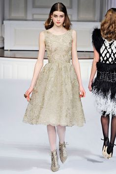 How did he even make this transition!?  I was just looking at crazy prints and fur and bold colors, and yet somehow I got here, and it was so natural...Oscar de le Renta