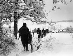4.Troops of the 3rd U.S. Army are seen as they march toward the village of Lutrebois, near Bastogne, on January 25, 1945, during the Battle of the Bulge