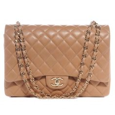 This is an authentic CHANEL Lambskin Quilted Maxi Double Flap in Beige.   This stunning shoulder bag is finely crafted of soft diamond quilted beige lambskin leather.