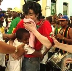 Michael Jackson on the set of They Don't Care About Us ;) He always loved babies and all children of the world ღ @carlamartinsmj