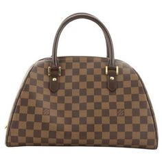 Authentic Louis Vuitton Ribera MM hand bag in Damier Canvas. Top is secured with double zipper. Inside is in red canvas lining with 1 open pocket and 1 for mobile or glasses. Perfect for daily use. Sac Luis Vuitton, Louis Vuitton Damier, Louis Vuitton Designer, Vuitton Bag, Vintage Louis Vuitton, Louis Vuitton Handbags, Louis Vuitton Speedy Bag, Brown Canvas, Vintage Bags