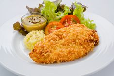 """Our homemade """"fried"""" chicken is baked, cutting down on the grease, and features a delightfully crunchy and lightly spicy breadcrumb coating."""