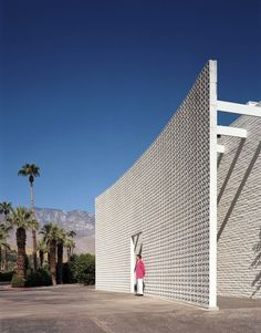 A brise soleil flanks the entrance of the Parker Palm Springs. Tagged: Exterior, Mid-Century Building Type, Concrete Siding Material, and Flat RoofLine. Photo 2 of 7 in Jonathan Adler Reveals His Redesign of the Parker Palm Springs. Palm Springs Hotels, Style Palm Springs, Parker Palm Springs, Palm Springs California, California Usa, Infinity Pools, Bungalows, Palm Springs Mid Century Modern, Parker Hotel