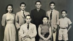 Mr Lee Kuan Yew (in black) with his family members, comprising siblings (clockwise from left) Monica, Dennis, Freddy and Suan Yew, as well as mother Chua Jim Neo and father Lee Chin Koon, in a family portrait shot at Lloyd Studio. This shot was taken the night before Mr Lee left for England to further his studies. -- PHOTO: COURTESY OF LEE KUAN YEW