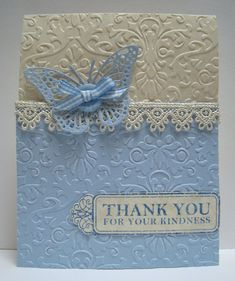 Blue butterflies, embossed card stock, ivory lace ... who could ask for anything more in a card.