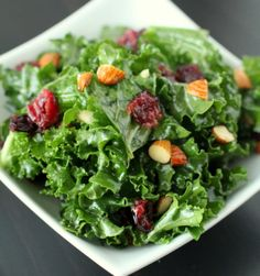 substituted spinach and lime juice... good!  orginal: citrus kale with roasted almonds and cranberries.  dressing sounds yummy.