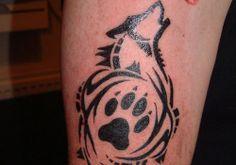 foot-wolf-tribal-tattoo-design ~ http://heledis.com/the-meaning-behind-the-scared-wolf-tribal-tattoo/