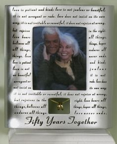 50th Anniversary frame with golden wedding rings.