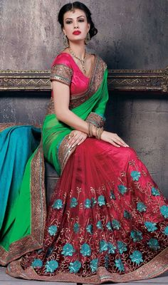 Flaunt pristine elegance dressed in this green and maroon color chiffon net half n half sari. It is really uniquely crafted with lace, stones and resham work. #buttaworksaree #maroonnetsari #chiffonhalfnhalfsaris