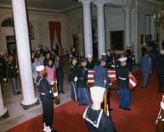 Jackie Kennedy (at left, still in her blood-stained pink suit) returns to the White House from Dallas with Pres. John F. Kennedy in his casket, before dawn November 23, 1963 after his November 22nd assassination. #JFK #JFK50