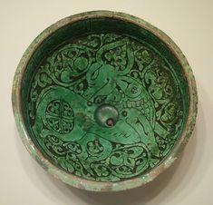 Bowl with prancing quadruped, Iran, Garrus district, Seljuk period, 12th or 13th century AD, earthenware with carved slip design under green glaze - Cincinnati Art Museum