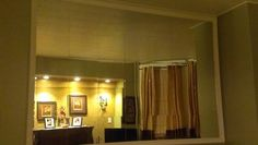 Square mirrors on the wall frame with inexpensive crown molding. And make a beautiful mirror frame. Looks very elegant.