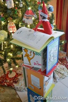Elf On the Shelf Ideas: Reading By The Light Of the Tree - Could use Disney Books to build the tower