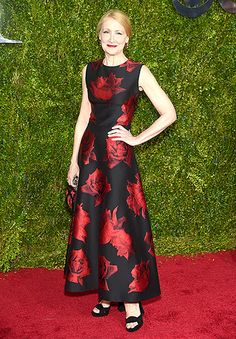 The Elephant Man nominee Patricia Clarkson walked the carpet in a black cocktail dress with a red floral print, a perfectly matched clutch, and peep-toe heels.
