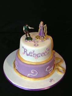 Rapunzel Tangled cake - Rapunzel Tangled two tier cake. Toppers provided by customer, hair painted with gold lustre.
