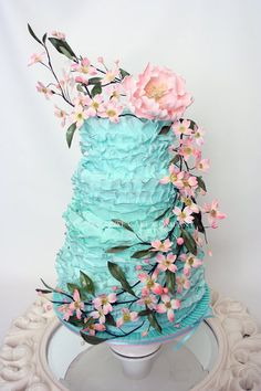 Love the idea just not the colors...Ruffled from top to bottom...  with pink dogwoods cascading down the cake and topped off with a pink peony | Cake by Sara CourtHouse Cake Company