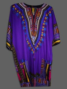 African Dashiki (DS2)    Magnificent African men clothing made from dyed cotton called Batik. This violet upper garment with elaborate embroidery makes a perfect wear.