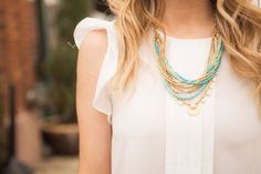 Add a cool toned necklace to a neutral outfit for the perfectly polished look.