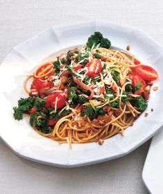 Whole-Grain Spaghetti With Garlicky Kale and Tomatoes | Need some quick dinner ideas? Try one of these speedy recipes that take just 15 minutes or less of hands-on work.