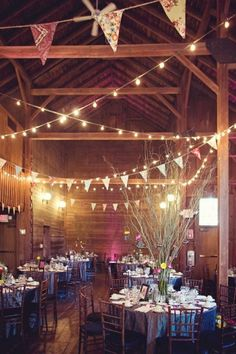 A fall wedding celebration would be amazing in an old, rustic barn, complete with flag banners and cafe lights! country
