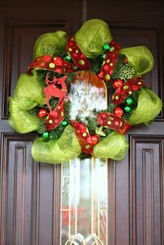 Amazingly creative and festive winter wreaths and door décor for the holiday season.