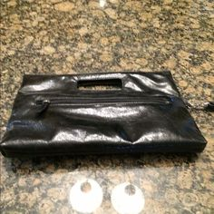 Sale ! Black clutch Two zippered pockets inside, one out. Used twice - like new. Bags
