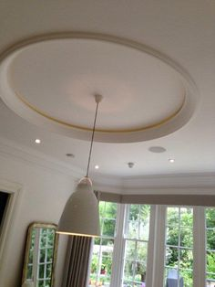 Classic Ceiling Rose, with contemporary light fixture. Classic cornicing - as seen in the background.