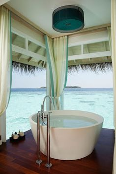 tub with an ocean view is a necessity