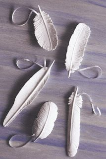 Clay Feathers: The link doesn't work, but I'm saving the picture for the idea.  Making Christmas ornaments for the family.