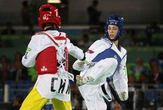 Tijana Bogdanovic from Serbia, right, and Wu Jingyu from China compete in women's -49kg Taekwondo match at the 2016 Summer Olympics in Rio de Janeiro, Brazil, Wednesday, Aug. 17, 2016.