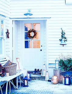 Cargo Home | Christmas House and front door with wreath and lanterns | The Relaxed Home
