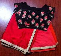 Red colour saree with black floral boat neck design blouse