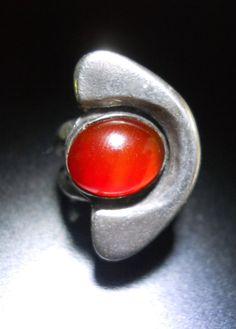 Offering a red agate sterling silver ring in a Danish modern design, vintage sz 6.5:  This is a thick and relatively heavy ring with an oval red